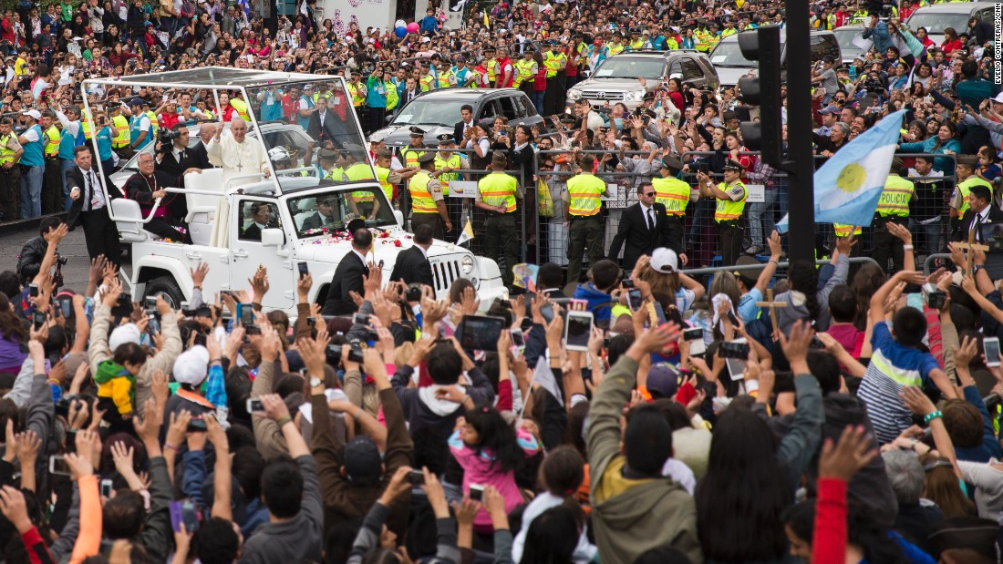 The Pope greets supporters in downtown Quito on Sunday, July 5.