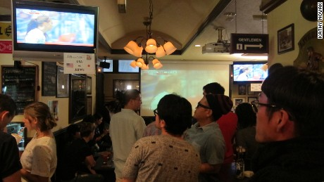 Japanese fans watch the match in a Tokyo bar