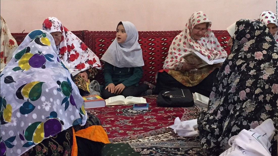 A girl recites verses from the Quran. The people of Abyaneh are Muslim, but they have preserved much of their culture from pre-Islamic times when the main religion in Persia was Zoroastrianism.