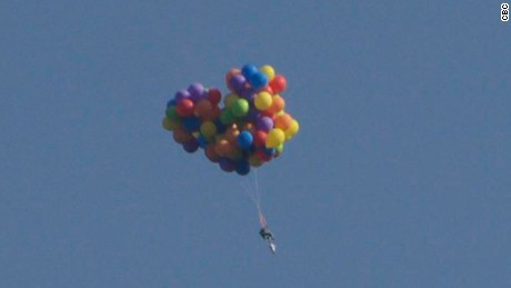 'Balloon man' soars in lawn chair, lands himself in jail