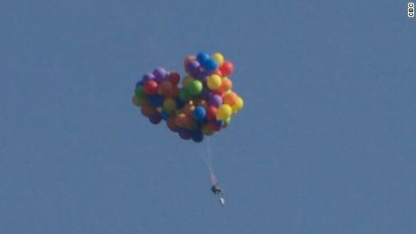 'Balloon man' soars in lawn chair, lands himself in jail
