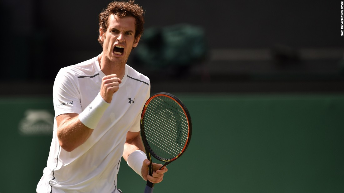 Andy Murray is pumping his fist and why not? He overcame the big serves of Ivo Karlovic in four sets and the 2013 champion next plays Canada's Vasek Pospisil.