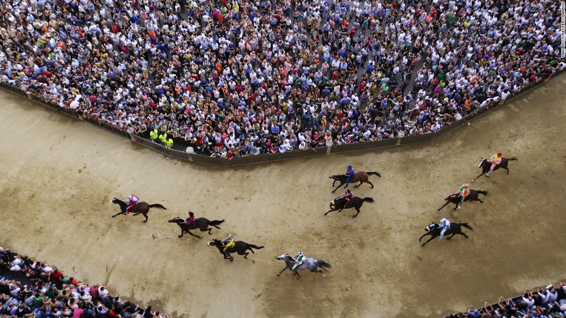 "A practice session is held Wednesday, July 1, for the Palio di Siena, a bareback horse race held twice a year in Siena, Italy. <a href=""http://www.cnn.com/2013/08/26/sport/worlds-craziest-horse-festivals/index.html"" target=""_blank"">The historic race</a> dates to the 17th century. Ten riders represent their local neighborhood as they race around the iconic city square three times."