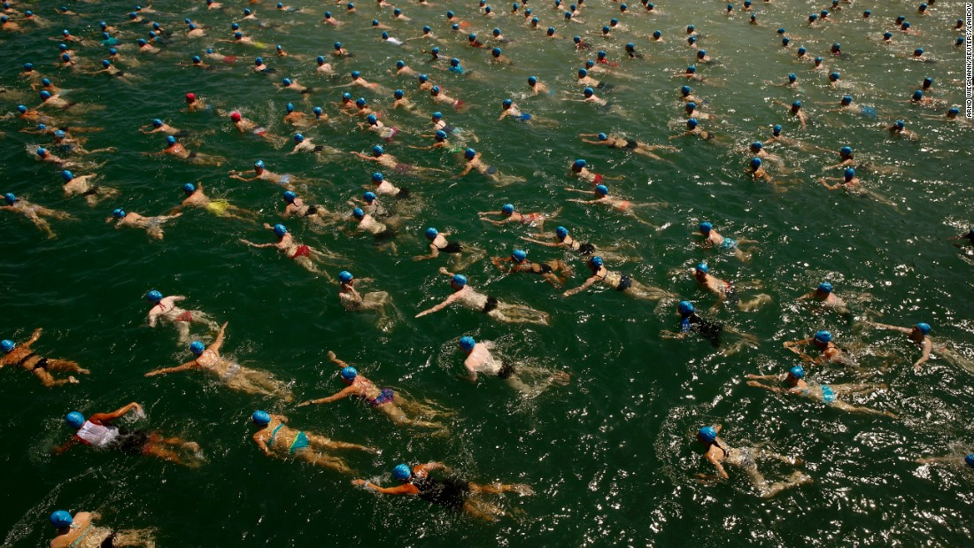 People swim across Lake Zurich during a public race held Wednesday, July 1, in Zurich, Switzerland. The race stretched over a distance of 1,500 meters (4,921 feet).