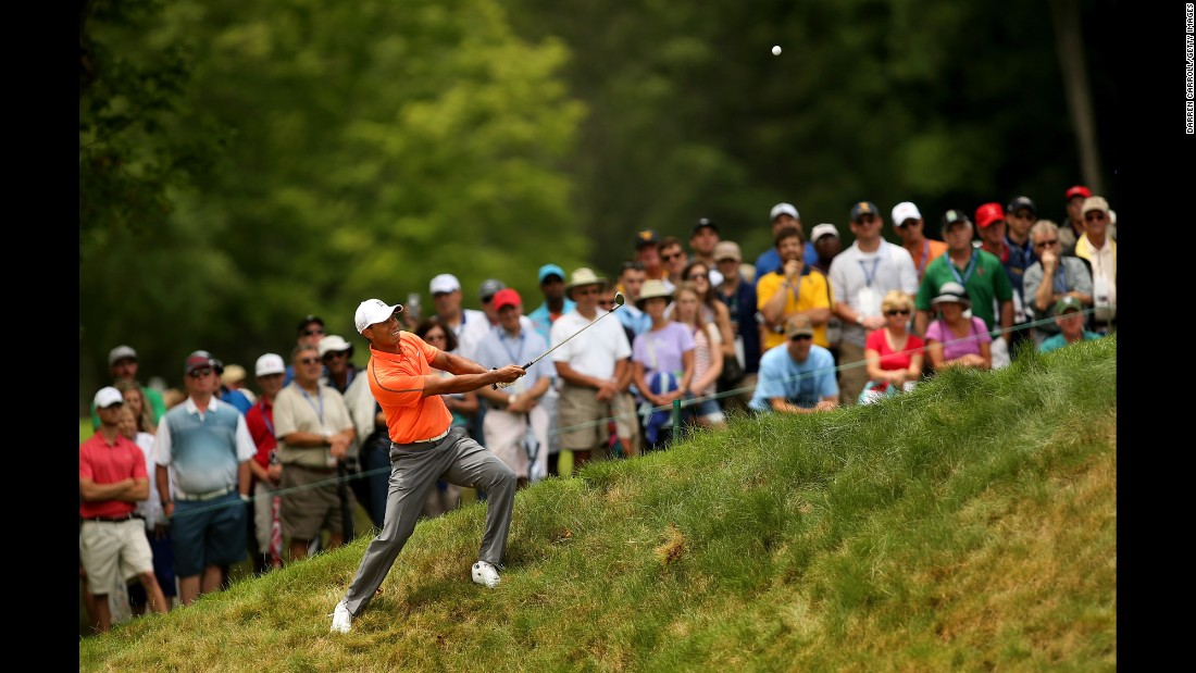 Tiger Woods hits a shot during the third round of the Greenbrier Classic on Saturday, July 4. Woods finished tied for 32nd in the event, which took place in White Sulphur Springs, West Virginia.