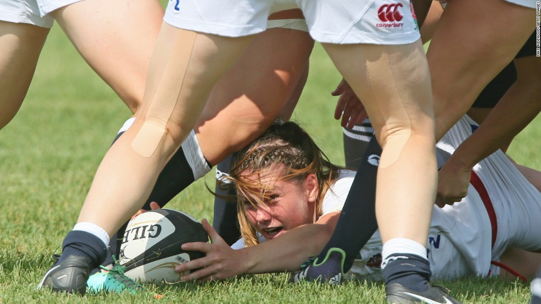 An England player battles for the ball while playing New Zealand in the Women's Rugby Super Series on Wednesday, July 1. New Zealand won the match 26-7 in Red Deer, Alberta.