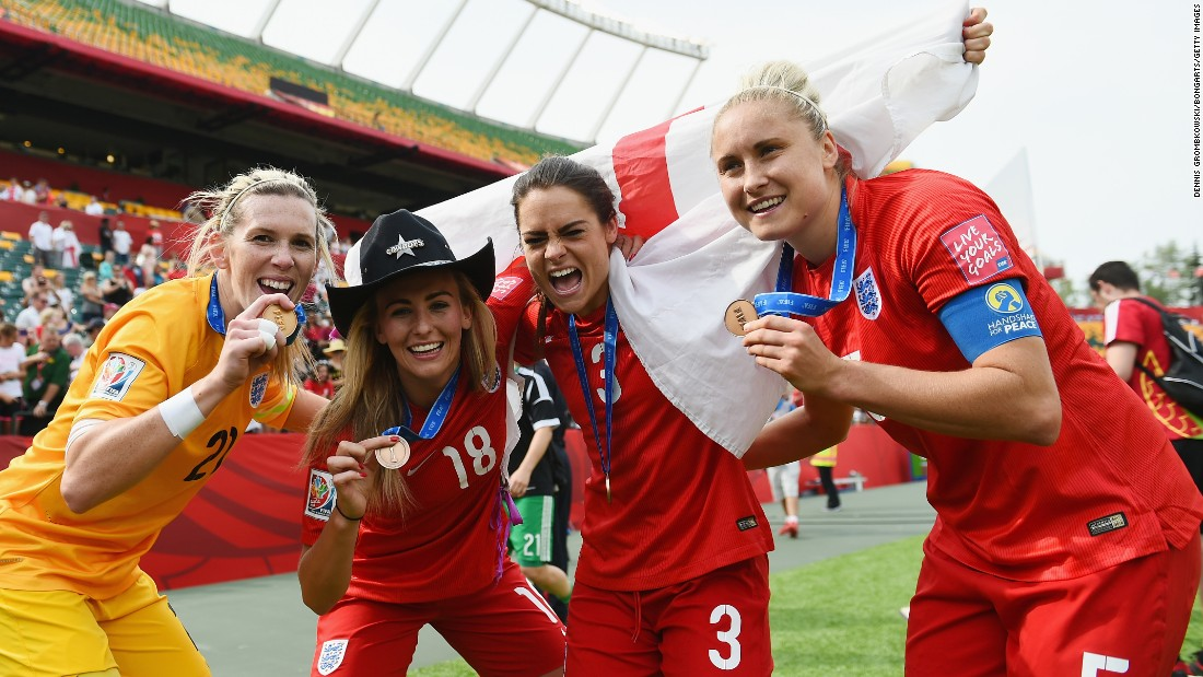 From left, England soccer players Carly Telford, Toni Duggan, Claire Rafferty and Steph Houghton show off their medals after defeating Germany 1-0 in the Women's World Cup third-place match on Saturday, July 4.