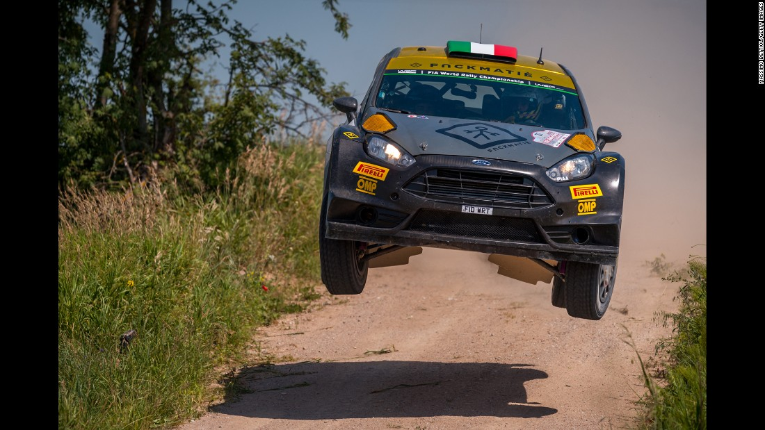 The rally car of Lorenzo Bertelli and Lorenzo Granai catches some air in Mikolajki, Poland, on Saturday, July 4.
