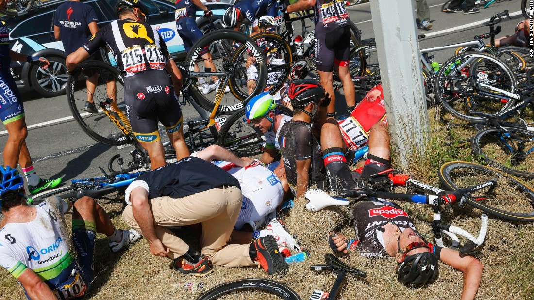 Riders and their bikes lay in crumpled heaps for several minutes as team and race officials rushed to their aid.