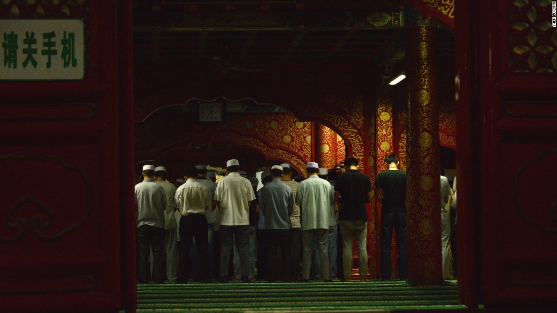 Men pray at the Niujie Mosque on July 6.
