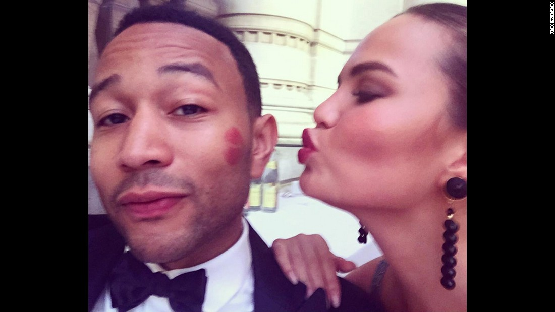 "Singer John Legend <a href=""https://instagram.com/p/4zrmICkSjQ/"" target=""_blank"">gets a kiss</a> from his wife, model Chrissy Teigen, on Monday, July 6."