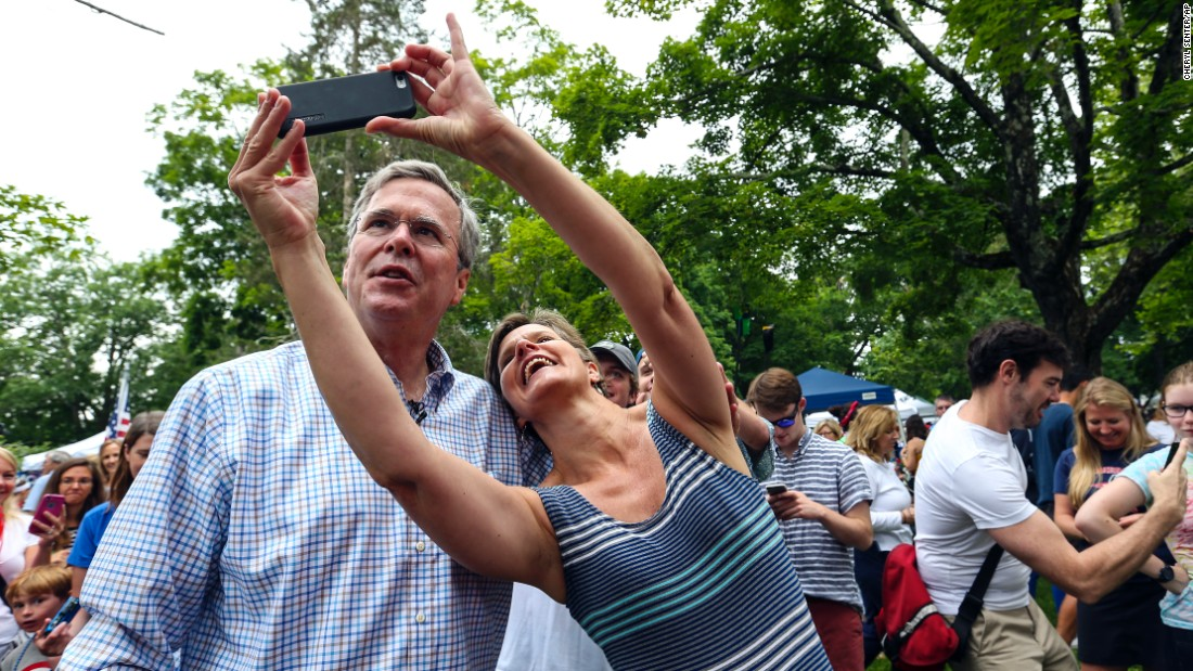 Republican presidential candidate Jeb Bush poses with a supporter in Amherst, New Hampshire, on Saturday, July 4.
