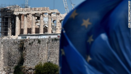 Caption:A European Union flag waves in front of the ancient temple of Parthenon atop the Acropolis hill in Athens on July 7, 2015. Eurozone leaders will hold an emergency summit in Brussels on July 7 to discuss the fallout from Greek voters' defiant 'No' to further austerity measures, with the country's Prime Minister Alexis Tsipras set to unveil new proposals for talks. AFP PHOTO /ARIS MESSINIS (Photo credit should read ARIS MESSINIS/AFP/Getty Images)