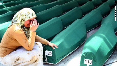 A Bosnian woman weeps next to the coffins of Muslim men and boys before their burial in Potocari, near Srebrenica, East Bosnia and Herzegovina.