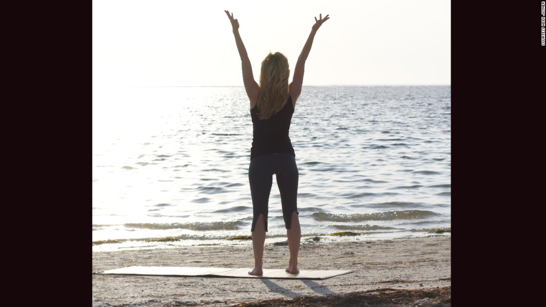 "<strong>Pride pose:</strong> Stand facing the water with your feet hip distance apart. Raise both arms above your head in a triumphant ""Y"" position -- the same pose you'd take if you just won a race. Hold for three to five long, deep breaths."