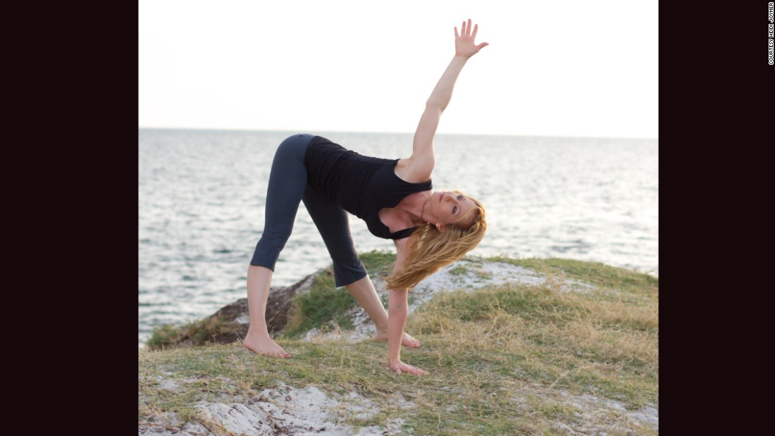 <strong>Standing straddle twist:</strong> Standing with feet as wide apart as you can while still feeling stable, bend forward to place your right hand on the ground in front of you. Reach your left arm forward and then rotate from your shoulder, ribcage and mid-back to reach skyward. Keep your hips and low back level while trying to align your shoulders vertically. Hold for two or three breaths. Repeat on the other side.