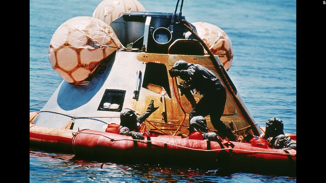 The U.S. Navy assists the returning astronauts after their re-entry vehicle landed safely in the Pacific Ocean on July 24, 1969.