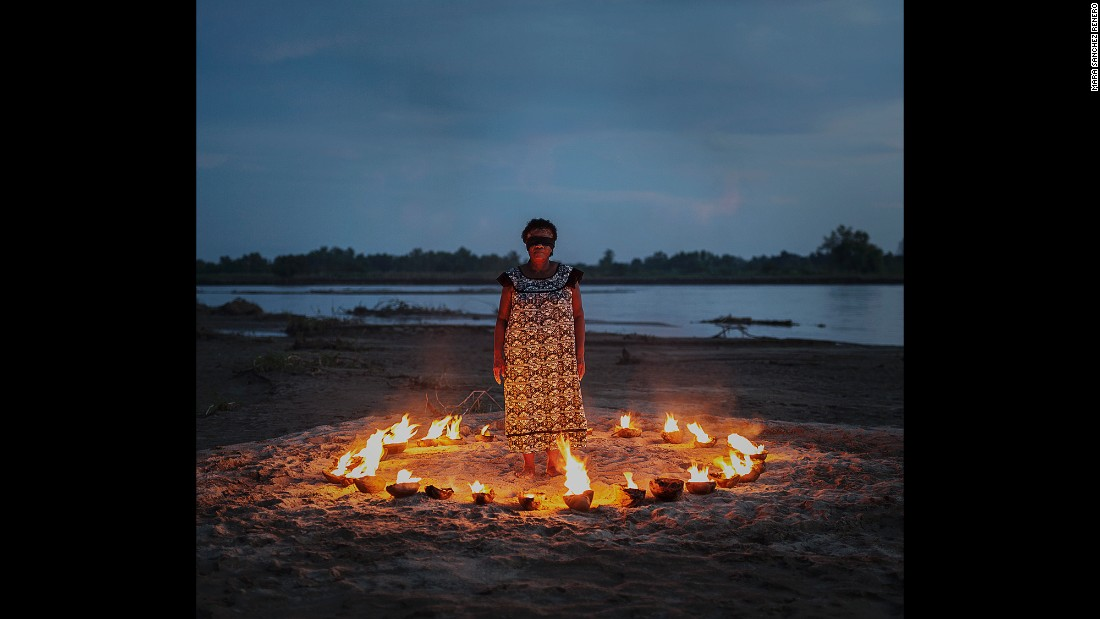 "The fire in this photo represents knowledge of tradition and identity, and the blindfold represents lack of awareness, Sanchez Renero said. ""Women are the ones who transmit identity and traditions,"" she said. ""There is some blindness with the women -- to not be aware of their own work, their own place, their own history."""