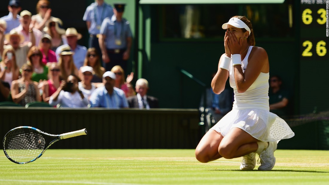 After hitting a winner on match point, Muguruza crumpled to the famous grass. She's the first Spanish woman to play in a grand slam final in 15 years.