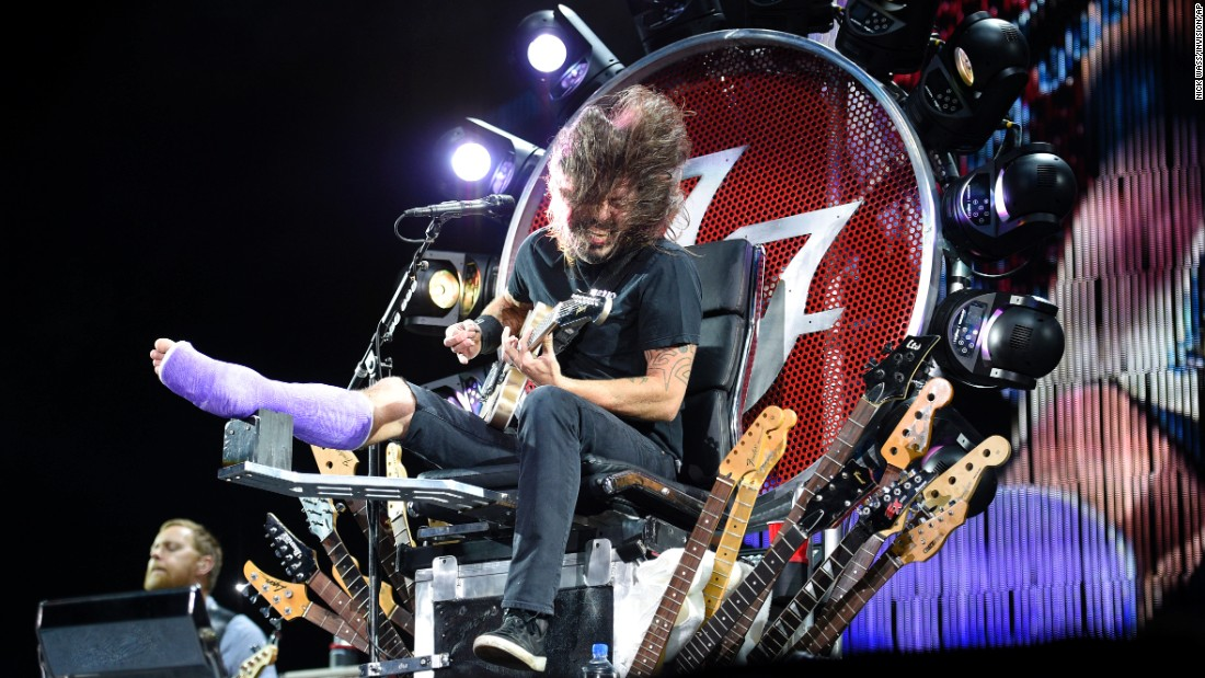 "Foo Fighters frontman Dave Grohl performs at RFK Stadium in Washington on Saturday, July 4. Grohl <a href=""http://www.cnn.com/2015/07/05/entertainment/dave-grohl-throne-foo-fighters-feat/"" target=""_blank"">broke his leg last month</a> after he fell off a stage in Sweden."
