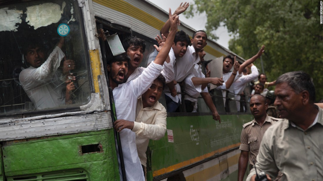 "Activists from the youth wing of India's Congress Party shout slogans from a bus in New Delhi as they are detained during a protest against Shivraj Singh Chauhan, chief minister of the Madhya Pradesh state, on Wednesday, July 8. Chouhan set up a special task force to investigate <a href=""http://www.cnn.com/2015/07/07/asia/india-vyapam-scandal-deaths/"" target=""_blank"">the Vyapam corruption scandal</a> that has been linked to dozens of suspicious deaths. But his critics say he hasn't done enough."