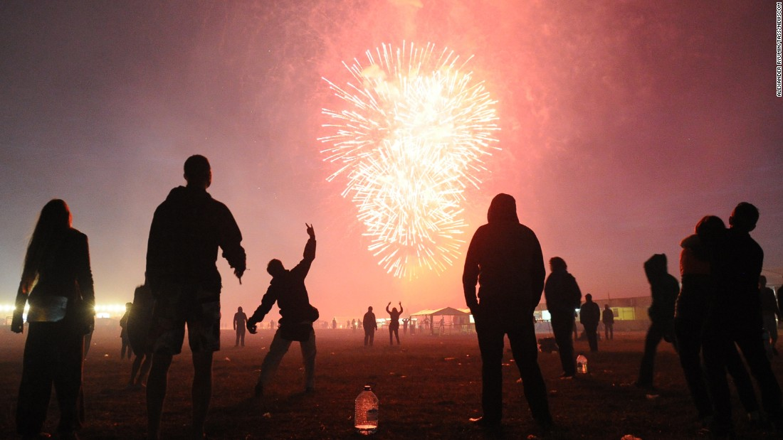 Fireworks go off Sunday, July 5, during the closing ceremony of the Invasion rock festival in Bolshoye Zavidovo, Russia.