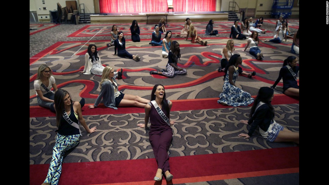 Miss Massachusetts, Polikseni Manxhari, laughs Monday, July 6, during a rehearsal for the upcoming Miss USA Pageant in Baton Rouge, Louisiana.