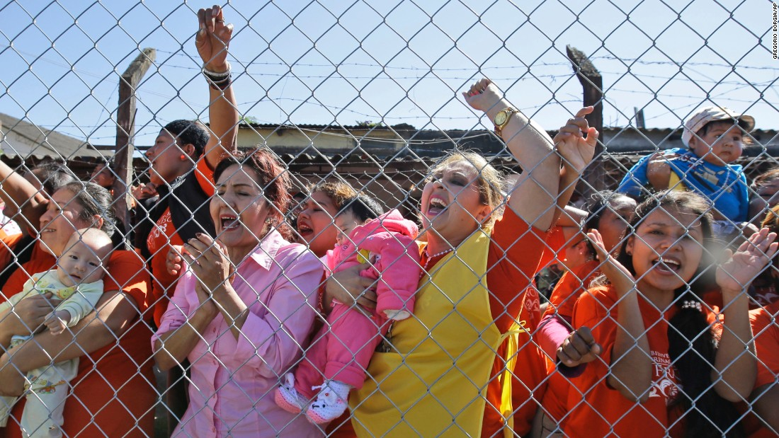 "Female inmates, some holding their babies, shout, ""We want your blessing!"" as the Pope leaves Palmasola prison on July 10."