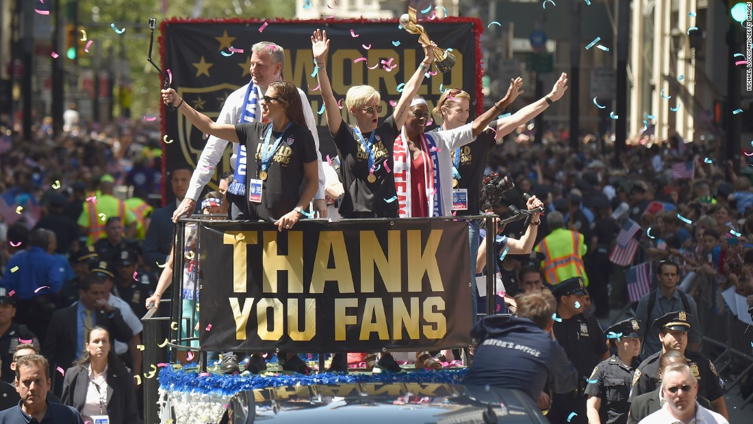 The U.S. women's soccer team celebrates its  World Cup victory with a ticker tape parade in New York on Friday, July 10. Midfielder Megan Rapinoe is holding the trophy.