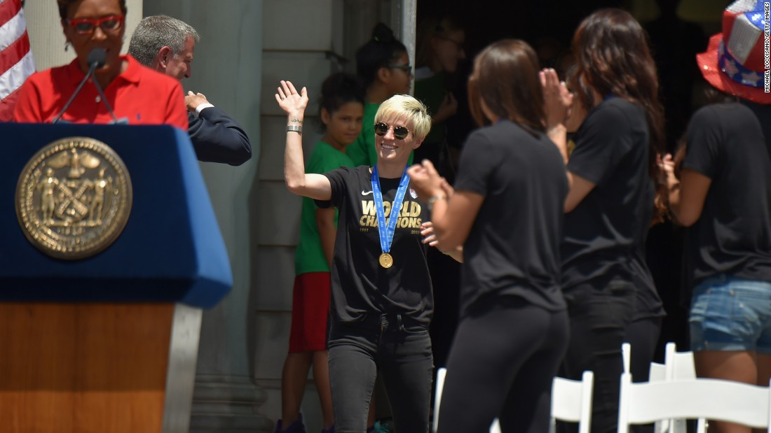 Robin Robbins, left, and Mayor Bill de Blasio celebrate soccer player Megan Rapinoe, center, and her fellow World Cup champions at City Hall.