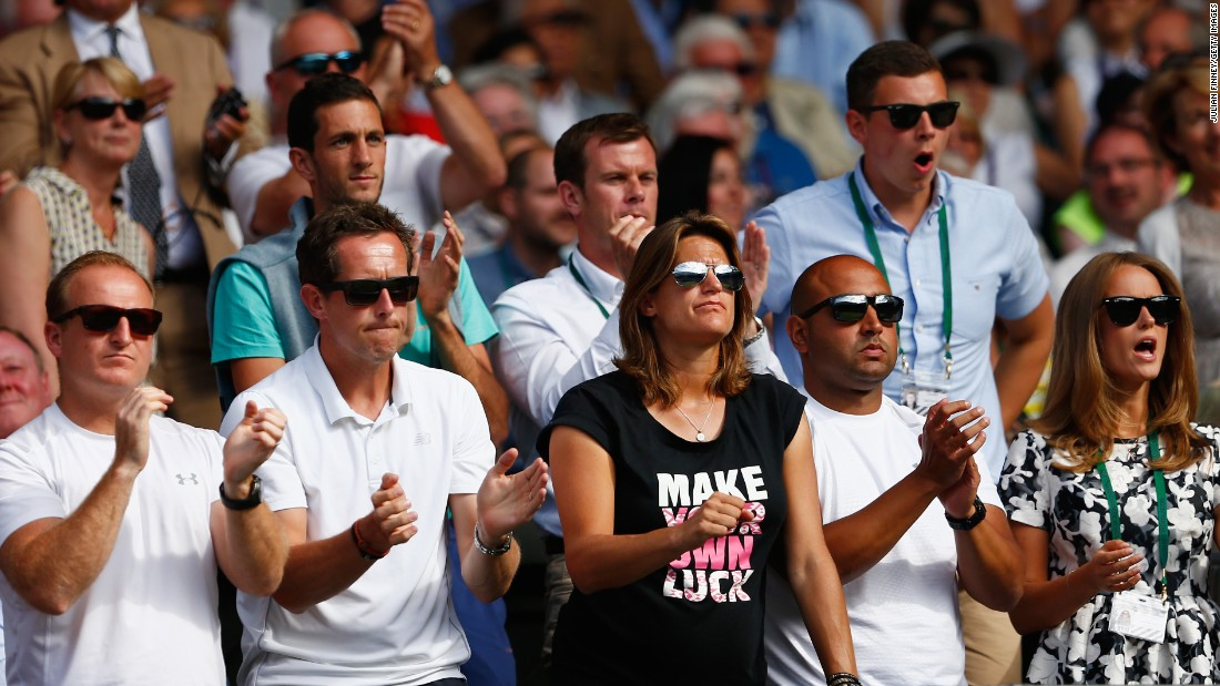 Murray was watched by his coaching team, including Amelie Mauresmo (center) and Jonas Bjorkman (2nd left). His wife Kim is far right.