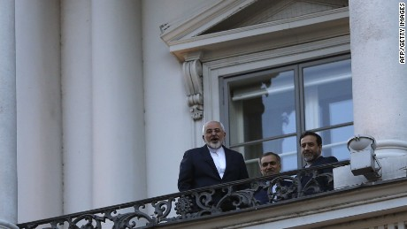 Iranian Foreign Minister Mohammad Javad Zarif (L) talks to journalist from a balcony of the Palais Coburg hotel where the Iran nuclear talks meetings are being held in Vienna, Austria on July 9, 2015. The United States and other major powers are not in a rush reach a nuclear agreement with Iran, though Washington and its partners will not negotiate with Tehran indefinitely, U.S. Secretary of State John Kerry said on Thursday. AFP PHOTO / POOL / CARLOS BARRIACARLOS BARRIA/AFP/Getty Images