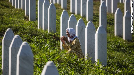 A woman prays at the Potocari cemetery and memorial near Srebrenica on July 10, 2015 in Srebrenica, Bosnia and Herzegovina. The newly-identified remains of another 136 victims from the Srebrenica massacre will be buried during a ceremony on July 11, 2015 on the 20th anniversary of the massacre. More than 8,000 Bosnian Muslim men and boys who had sought safe heaven at the U.N.-protected enclave at Srebrenica were killed by members of the Republic of Serbia army under the leadership of General Ratko Mladic, who is currently facing charges of war crimes at The Hague, during the Bosnian war in 1995.