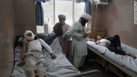Afghans lie on hospital beds after being wounded in a bombing in Kandahar, Afghanistan, Saturday, July 11, 2015. The bomb exploded near a religious school in Kandahar, killing several children and wounding others, according to Samim Khpolwak, a spokesman for the provincial governor in Kandahar province. (AP Photo/Allauddin Khan)
