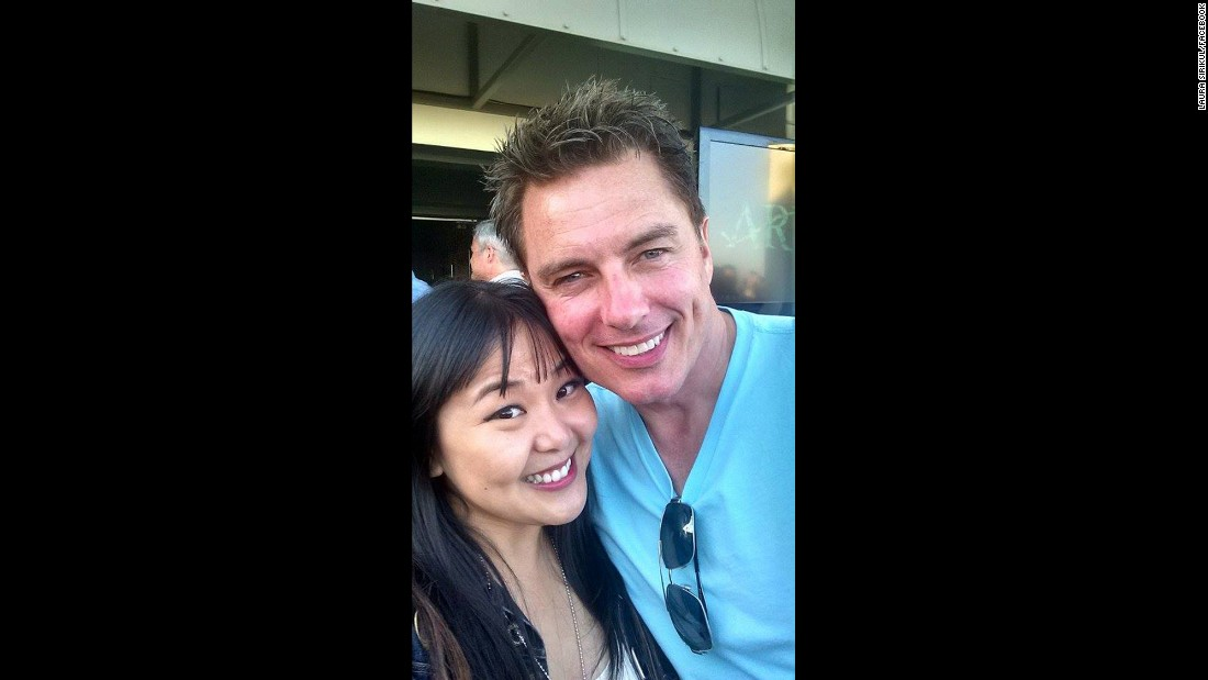"Between ""Doctor Who,"" ""Torchwood"" and ""Arrow,"" John Barrowman is Comic-Con royalty, so Laura Sirikul made a point to get a photo with him."