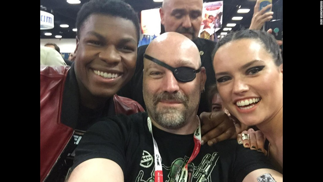 "It's rare for celebrities to brave the crowds on the convention floor, but John Boyega (left) and Daisy Ridley did just that. The stars of ""Star Wars: The Force Awakens"" got this selfie with hardcore fan Eliot Sirota."