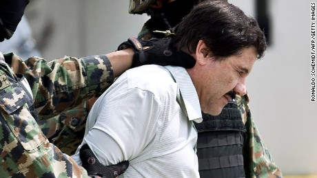 "Joaquin ""El Chapo"" Guzman is escorted by marines as he is presented to the press on February 22, 2014, in Mexico City."