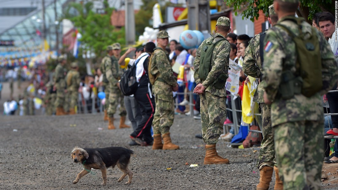 Soldiers stand guard in Asuncion's Banado Norte neighborhood ahead of the Pope's arrival on July 12.