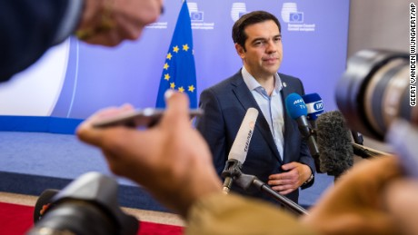 "Greek Prime Minister Alexis Tsipras speaks with the media after a meeting of eurozone heads of state at the EU Council building in Brussels on Monday, July 13, 2015.  A summit of eurozone leaders reached a tentative agreement with Greece on Monday for a bailout program that includes ""serious reforms"" and aid, removing an immediate threat that Greece could collapse financially and leave the euro. (AP Photo/Geert Vanden Wijngaert)"