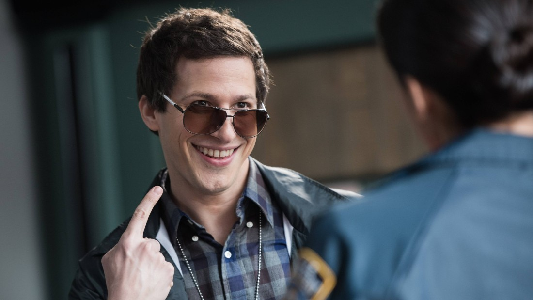 "BROOKLYN NINE-NINE: Det. Peralta (Andy Samberg) displays his cool new look in hopes of impressing Det. Dave Majors (guest star Garret Dillahunt), in ""Det. Dave Majors"" episode of BROOKLYN NINE-NINE airing Sunday, May 3 (8:30-9:00 PM ET/PT) on FOX. ©2015 Fox Broadcasting Co. CR: Eddy Chen/FOX."