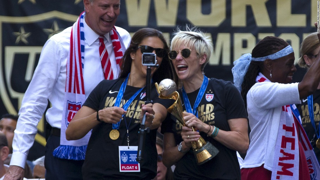 "U.S. soccer players Carli Lloyd, left, and Megan Rapinoe take a selfie with the Women's World Cup trophy <a href=""http://www.cnn.com/2015/07/10/us/gallery/us-soccer-team-parade/index.html"" target=""_blank"">during a parade in New York City</a> on Friday, July 10. Behind Lloyd and Rapinoe is New York Mayor Bill de Blasio."