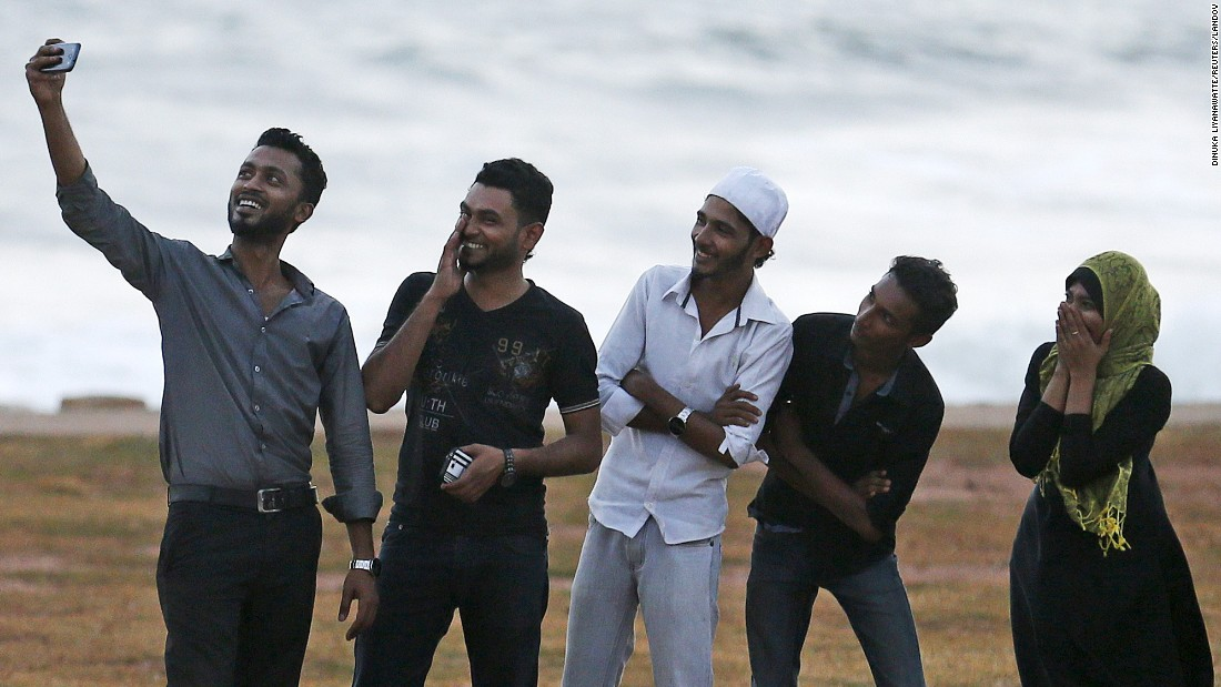A man takes a selfie with his friends in Colombo, Sri Lanka, before breaking fast on Wednesday, July 8. During the holy month of Ramadan, Muslims abstain from food and drink during daylight hours.<br />