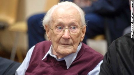 LUNEBURG, GERMANY - JULY 15:  Oskar Groening, 94, a former member of the Waffen-SS who worked at the Auschwitz concentration camp during World War II, awaits the verdict in his trial on July 15, 2015 in Lueneburg, Germany. Groening was accused of complicity in the murder of 300,000 mostly Hungarian Jews at Auschwitz in 1944. He worked as an accountant for the SS at Auschwitz and has admitted moral and personal responsibility for his role there. Groening has been convicted of being an accessory to murder, and sentenced to four years in prison. (Photo by Hans-Jurgen Wege/Getty Images)