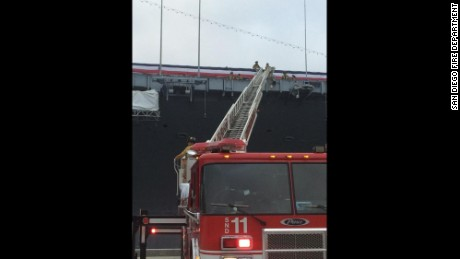 A San Diego fire department ladder extends onto the USS Midway.