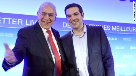 "OECD Secretary General Angel Gurria (L) and Greek Prime Minister Alexis Tsipras pose during Tsipras' visit to the OECD headquarters in Paris, on March 12, 2015. Greece announced on March 12 that it has officially launched a partnership deal with the OECD to draw up economic reforms, which Prime Minister Alexis Tsipras said would help rebuild trust with international creditors. The slogan behind reads ""Better politics for better lives"". AFP PHOTO / ERIC FEFERBERGERIC FEFERBERG/AFP/Getty Images"