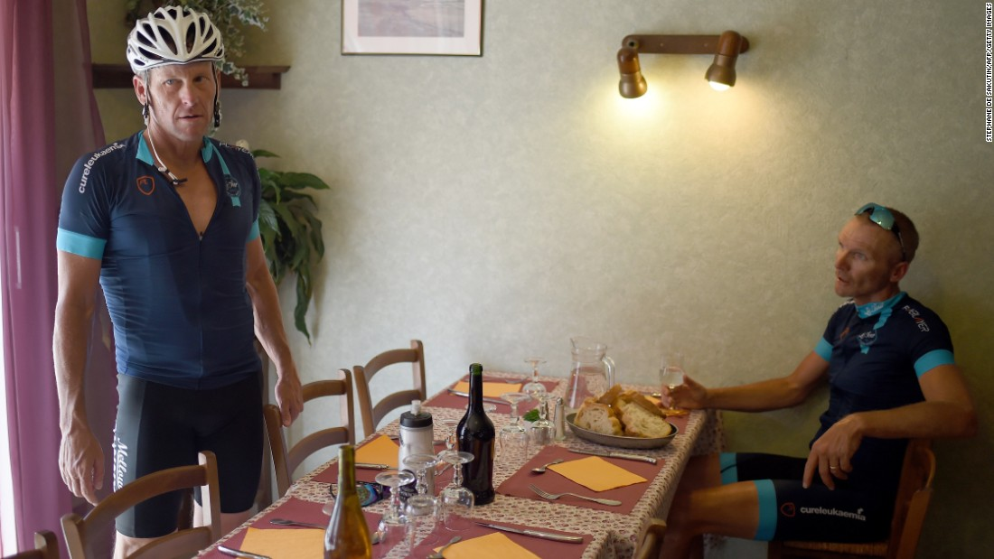 Armstrong (left) agreed to take part for the charity ride organized by former English soccer player Geoff Thomas (right). They had lunch in the village of Villefranche d'Albigeois, southwest France.
