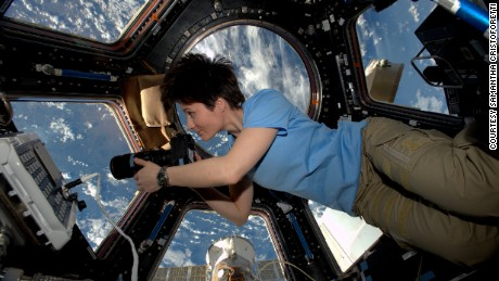 How do women handle their periods in space?