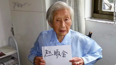 Zhao Shunjin, 100,  holds up a piece of paper with her name written on it in her own handwriting at her home in Hangzhou, China  on July 16, 2015.