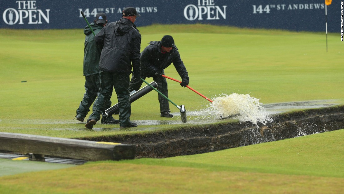 Happily there was somewhere for all the water to go as green staff armed with squeegees brush the puddles into the famous Swilcan Burn.