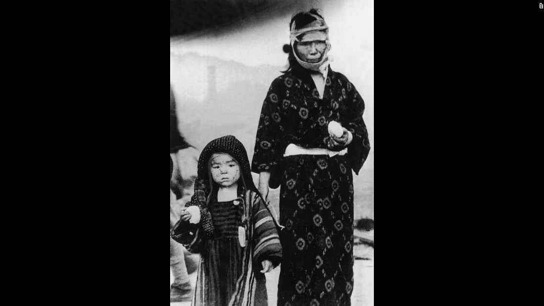 A woman and a child walk in Nagasaki on the day of the bombing. More than 70,000 people there were killed instantly.